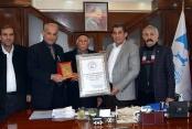 Emekliler Derneğinden Başkan Atilla'ya Üstün Başarı ve Plaket