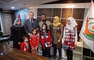 Erdoğan, şehit olan 9 aylık bebeğin ailesi ile...